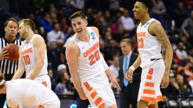 Syracuse Orange freshmen Tyler Lydon, left, and Malachi Richardson smile Sunday after the game against the Middle Tennessee Blue Raiders in the second round in the 2016 NCAA Tournament at Scottrade Center. Syracuse won, 75-50, and advanced to the Sweet 16.