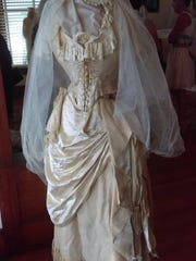 """This vintage gown is one of wedding historian Leigh Anne Brown's collection featured in """"Portrait of a Bride: An Evolving Silhouette,"""" a special event to benefit the nonprofit Alva Museum"""
