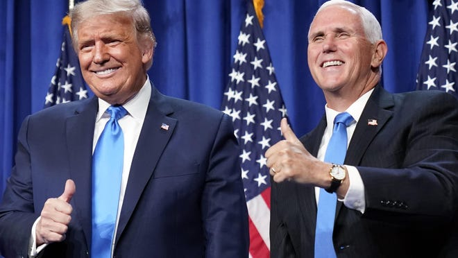 President Donald Trump and Vice President Mike Pence gesture at the 2020 Republican National Convention in Charlotte, N.C., Monday, Aug. 24, 2020.