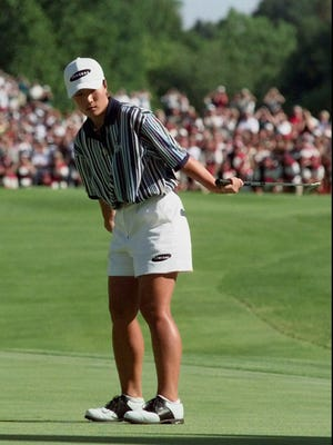 Korea's Se Ri Pak watches her birdie putt on the 18th hole during the final round of the U.S. Women's Open at Blackwolf Run in 1998. Her victory in an 18-hole playoff against Jenny Chuasiriporn fueled an explosion of popularity for women's golf in Korea.