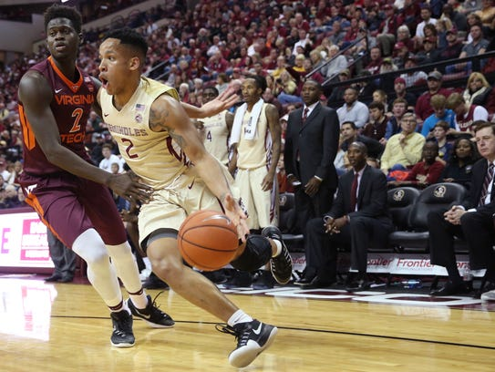 Florida State sophomore point guard CJ Walker carries