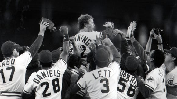 The Reds sweep pitcher Tom Browning off his feet after striking out the Dodgers' Tracy Woodson for the final out of his 1-0 perfect game Friday, 9/16/88.