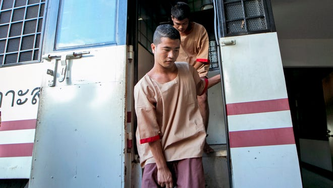 Myanmar migrants Win Zaw Htun, front, and Zaw Lin, both 22, arrive at court in Koh Samui, Thailand,  Dec. 24, 2015.