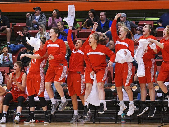 Rapid City Central players react from the bench after