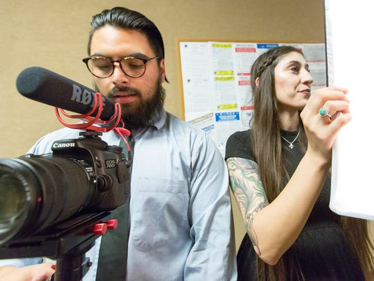 Southwest Creative Co. owners Bianca Padilla, 25, and Anthony Quiterio, 23, set up their camera and lights on Wednesday, December 21, 2016 at Hadley Hall on the New Mexico State University campus.