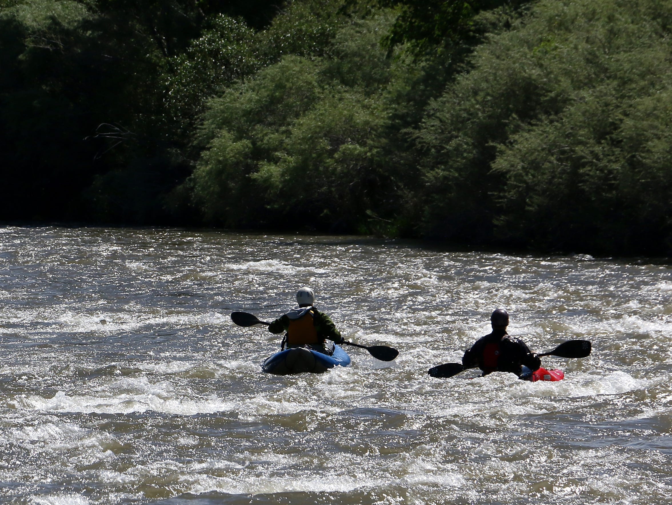 Ben Spillman and Noah Fraser paddle the Truckee River