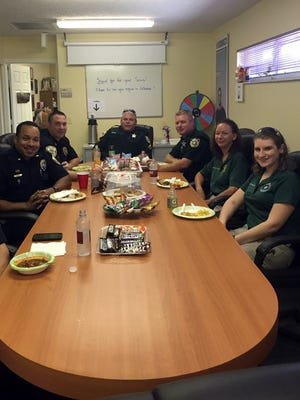 First responders enjoy a free meal at Century 21 All Professional.