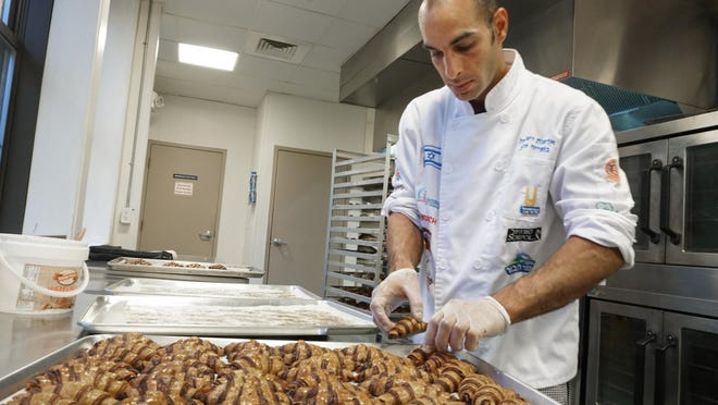 Baker Guy Hanuka prepares trays of chocolate rugelach, hot out of the oven. He is baking at Hope & Main.