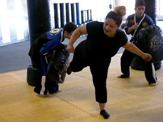 Elizabeth Talamantes practices a self-defense move during Team Chip Tae Kwon Do San Angelo's free monthly women's self-defense class Saturday, Jan. 20, 2018.