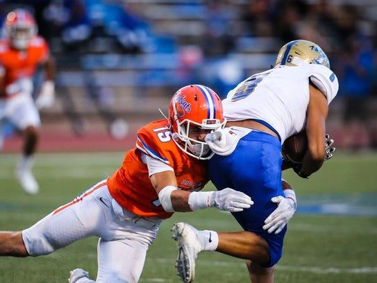 Central High School senior linebacker Noah Gatton tackles