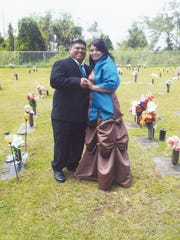 Eduardo C. Palma, left, and Tiffany Rose Millon married at Guam Memorial Park in Layon, Barrigada on May 30. The couple opted to wed at the cemetery where the groom's grandparents are buried, as he had promised them they would be at his wedding.