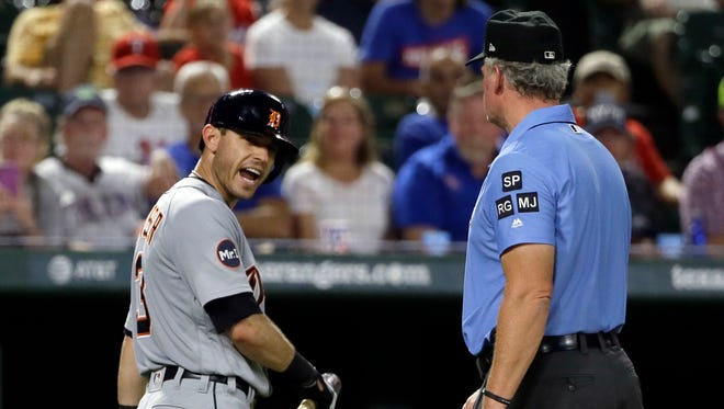 Tigers second baseman Ian Kinsler, left, argues with crew chief Ted Barrett, right, after Kinsler was ejected by home plate umpire Angel Hernandez in the fifth inning Aug. 14, 2017 in Arlington, Texas.