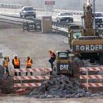 Drivers travel Wednesday along Interstate 10 East at the Executive Center Boulevard exit amid concrete barriers adjacent to a construction area.