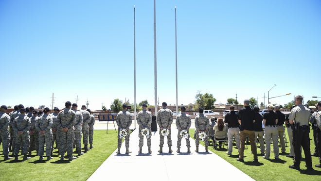 Members from local police departments and Airmen from Holloman Air Force Base Security Forces Squadron participate in a closing ceremony during National Police Week at Holloman Air Force Base, N.M. on May 15, 2017. National Police Week was established in 1962 by President John F. Kennedy to pay tribute to law enforcement officers who lost their lives in the line of duty for the safety and protection of others, according to the National Peace Officer's Memorial Fund website. Ceremonies are held annually in Washington D.C., as well as in communities across the nation.