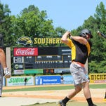 Southern Miss players prepare to take batting practice Tuesday.