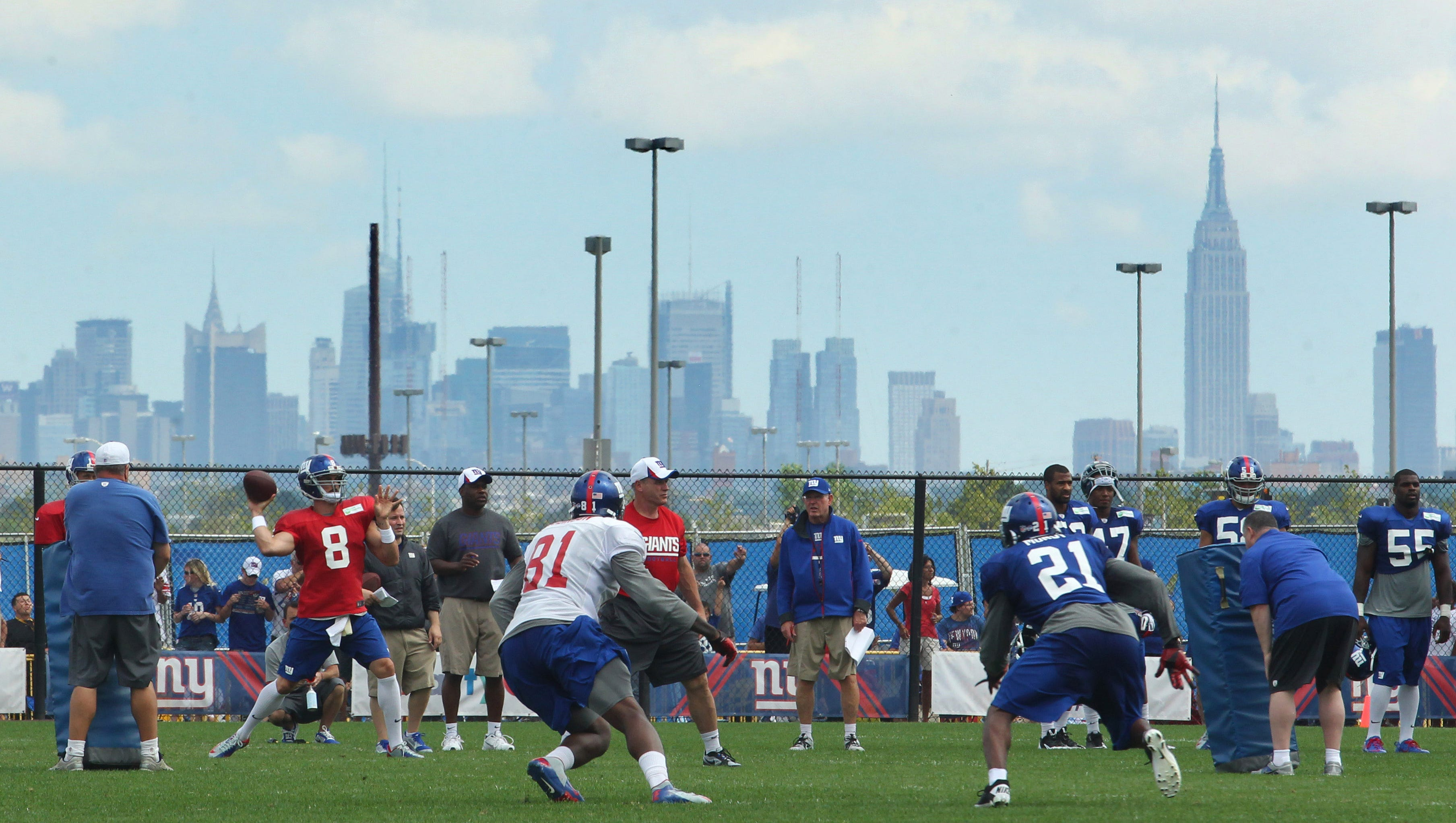 The Giants practice in East Rutherford, N.J., on Aug. 7 with the New York skyline as the backdrop.