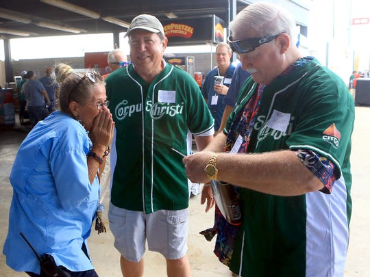 Rhonda Kribbs (left) giggles as they she gets photos from members of the 1967 King baseball team on Saturday, Saturday, June 24, 2017, at Whataburger Field in Corpus Christi.