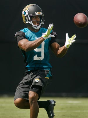 Jacksonville Jaguars wide receiver Nathan Slaughter (9) catches a pass during the first day of training camp at Florida Blue Health and Wellness Practice Fields in Jacksonville, Fla., on July 25, 2014.
