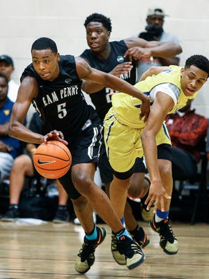 Team Penny forward D.J. Jeffries (left) grabs a loose ball away from Boo Williams guard Keldon Johnson (right) during action at the 2017 Nike Peach Jam in North Augusta, S.C.