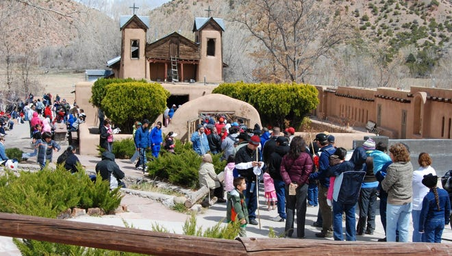"""During Holy Week thousands of pilgrims journey to El Santuario de Chimayó, a tiny shrine in northern New Mexico."