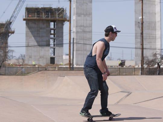Haslett resident Josh Taylor skates at the Ranney Skatepark