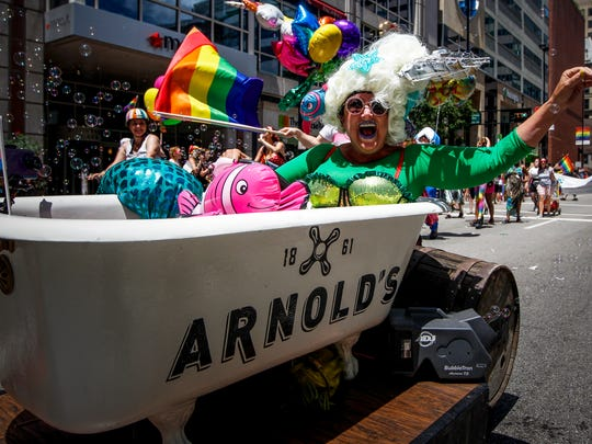 The float from Arnold's Bar and Grill passes the crowds at Fountain Square during the 2017 Cincinnati Pride Parade Saturday, June 24, 2017 in Downtown.