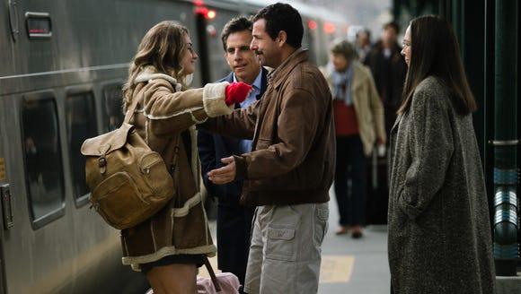 Ben Stiller, center, and Adam Sandler with Grace Van