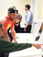 South Burlington residents David Lloyd, left, and Nic Anderson on Tuesday discuss options for improved cyclist and pedestrian safety along Williston Road at the I-89 interchange. Photographed April 18, 2017.