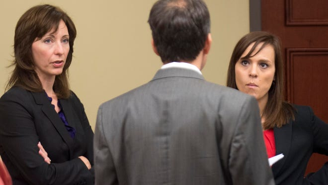 Campbell County General Sessions Court Judge Amanda Sammons, left, with her attorneys Wade Davies, center, and Heather Good during a break after jury selection on Tuesday, November 1, 2016.
