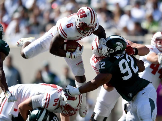 Wisconsin running back Corey Clement hurdles a Michigan State player on Sept. 24 at Spartan Stadium in East Lansing, Michigan.