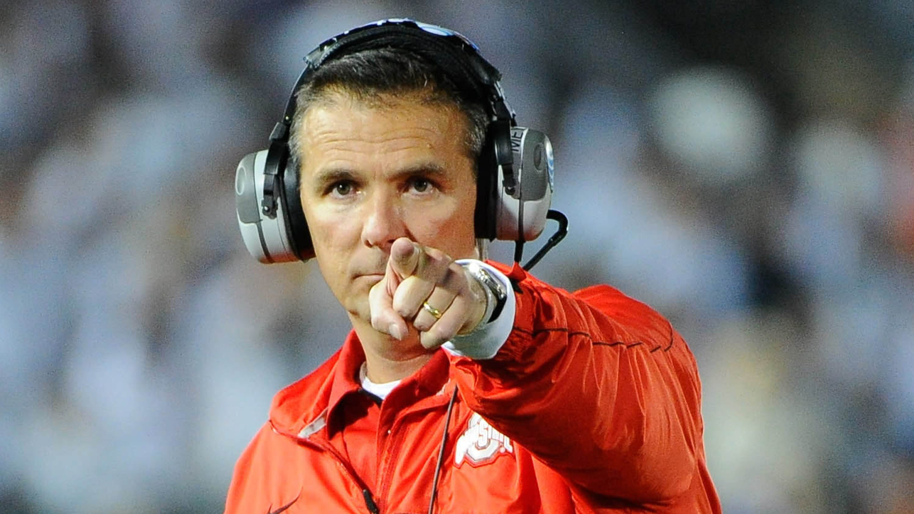 In this Sept 17 2016 file photo Ohio State head coach Urban Meyer right and thenassistant coach Zach Smith left gesture from the sidelines during a