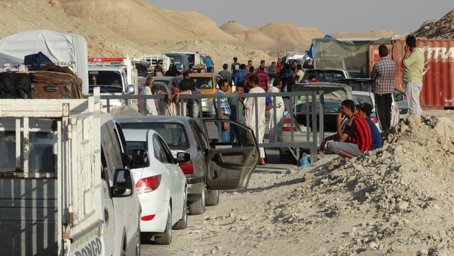 Iraqi family members prepare to leave their hometown of Ramadi, the capital of Anbar province, 115 kilometers (70 miles) west of Baghdad, Iraq, Friday, May 15, 2015. Islamic State militants seized the center of Ramadi in western Iraq and raised their black flag over the government compound, local officials said. (AP Photo)
