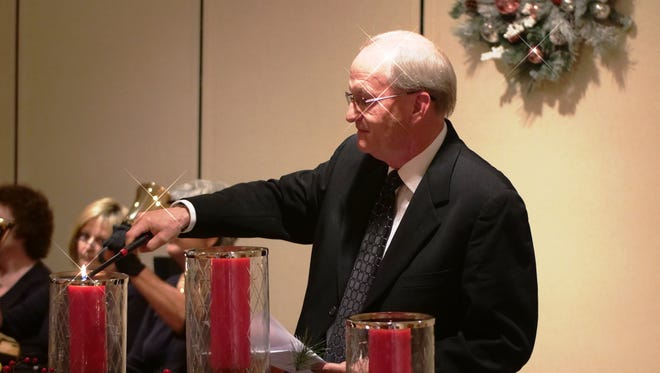 Rev. Joel A. Reif leads an interactive candlelighting ceremony Dec. 5 at the Light of Hope Community Candlelight Remembrance, held to honor the memory of loved ones.