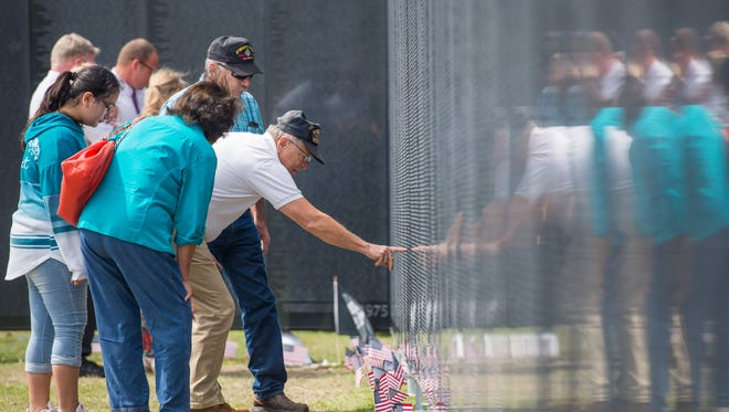 """Visitors to """"The Wall That Heals"""" in Portland. The replica of the Vietnam Veterans Memorial and accompanying mobile education center arrives in Howell on Aug. 21 and will remain through Aug. 26 as part of a national tour."""