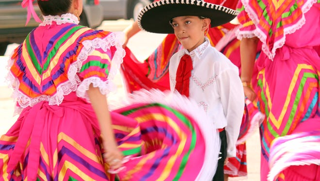 Members of Ballet Folklorico Diamantes del Valle of Las Cruces performed for the 67th annual St. Ann Catholic Church Fiesta Saturday at the church, 400 S. Ruby St. The fiesta was held at the church for the first time.