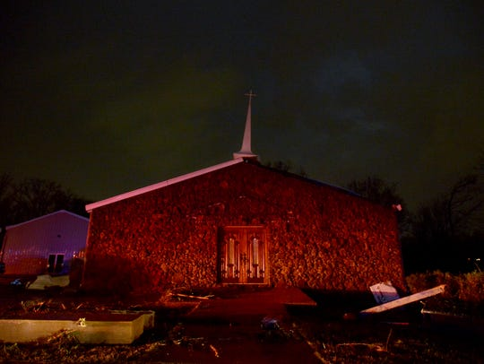 Falcon Road Baptist Church sands amongst storm damage