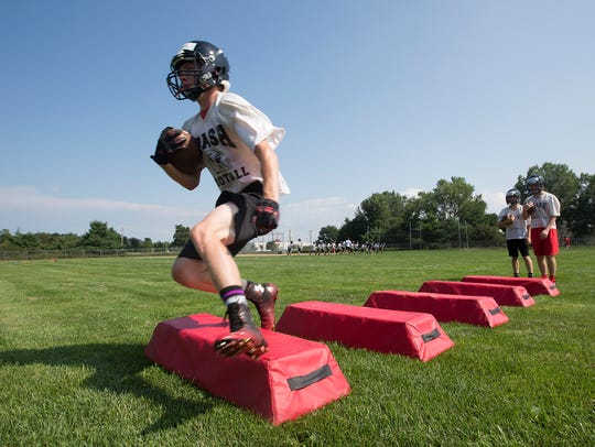 SPASH football players go through drills during football