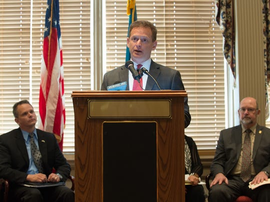 Delaware Attorney General Matt Denn speaks Wednesday about legislation to expand substance abuse treatment and reduce overprescription of opioids during a press conference at Legislative Hall in Dover.