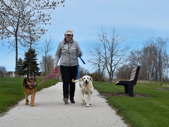 Taking more walks with Roxy, left, and Brickle, is definitely on the retirement agenda for Investigative Sgt. Connie Schuster.