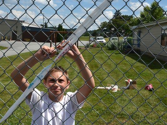 Teen program plarn bombs fence