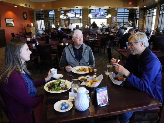 Rebecca Davis, left, of Dallas, enjoys lunch with Bryan Morris, center, of El Paso, and Jan Madey, of Houston, on a recent February day at the Butterfield Trail Golf Club's restaurant. The golf course, owned by El Paso Airport, has lost millions of dollars since it opened in June 2007.
