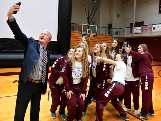 Freed Hardeman University President David Shannon takes a selfie with the 2018 NAIA Women's Basketball National Champions after a ceremony held to congratulate them on their win, Thursday, March 22.