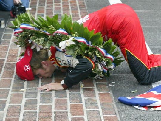 Dan Wheldon of Great Britain kissed the yard of bricks