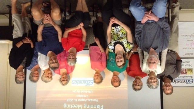 Pictured are, back row, from left: Tom Schuppe, Karen Lindberg Schuppe, Jeff Reese, Dan Belzer, BJ Belzer, Susanne Dennis, Lisette Aldrich, Jane Dennis and Bev Gudex. Front row, from left: David Demezas, Diana Tscheschlok, Jeanne McDowell and John McDowell.