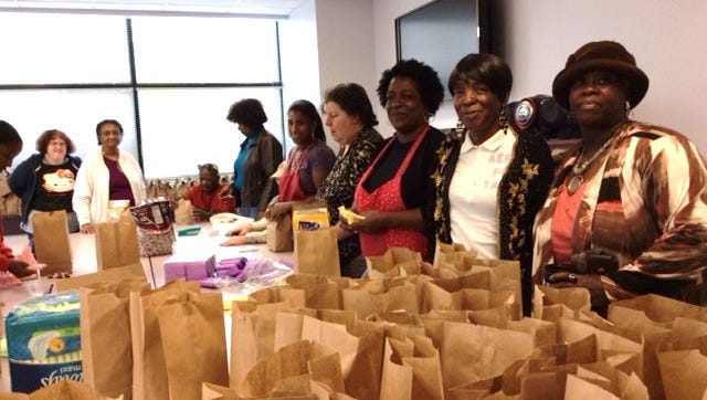 Seniors at Charles Settlement House sort sanitary products into kits for women in need during a P.A.D. project in 2015.