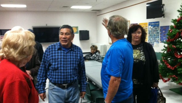 Fred Morales, center, speaks with audience members who attended his lecture on the history of Northeast El Paso in December 2015.