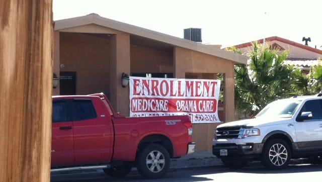 """Obamacare"" enrollment signs along 2200-2300 blocks of Montana Avenue."