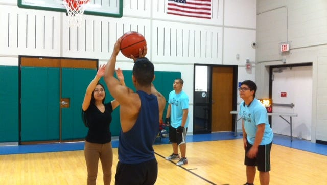 A 3-Point Shooting Contest, for ages 14 and older, will be held from 6 to 7:15 p.m. April 27 during the YMCA of Vineland's open house. Lorenzo Leyva, who is guarded by Cazendra Luciano, takes a shot, as Jack Luciano and Juno Luciano (right) prepare for the rebound.
