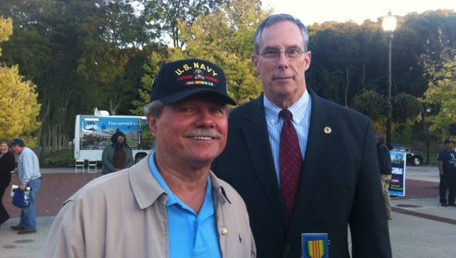 Vietnam veteran Michael Zygmunt holds his Westchester County Vietnam Service Medal with retired Army Maj. Gen. James T. Jackson, director for The United States of America Vietnam War Commemoration at a ceremony at Kensico Dam on Oct. 5, 2016.