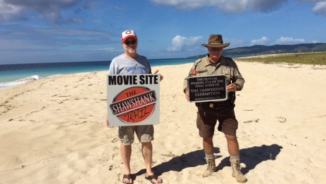 "Bill Mullen of Upper Sandusky, at left, stands with Michael Evans, a ranger with the U.S. Fish and Wildlife Service, on a beach on St. Croix, where the final scene in ""The Shawshank Redemption"" was filmed."